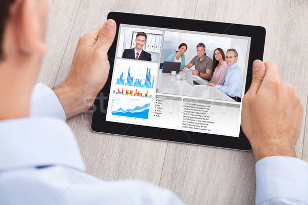 Businessman Video Conferencing With Team On Digital Tablet Stock photo © AndreyPopov