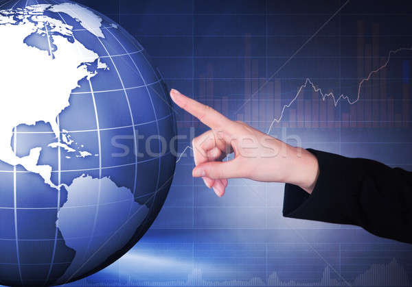 Businesswoman Touching Globe Stock photo © AndreyPopov