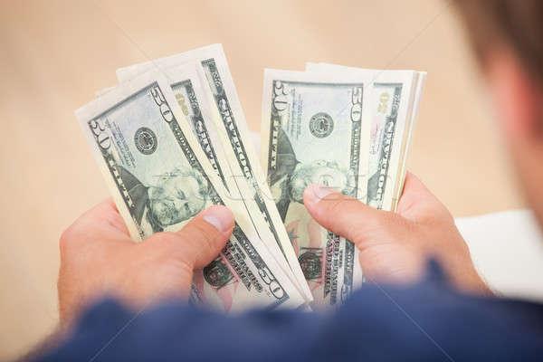 Man Counting Fifty Dollar Bills Stock photo © AndreyPopov