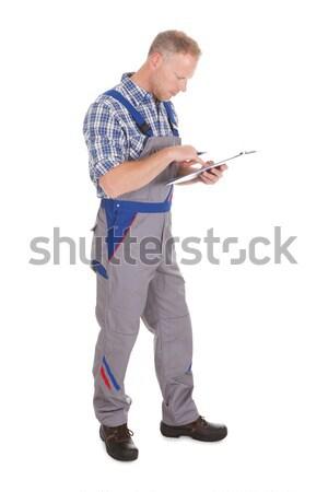 Souriant bricoleur clé à molette portrait adulte Photo stock © AndreyPopov