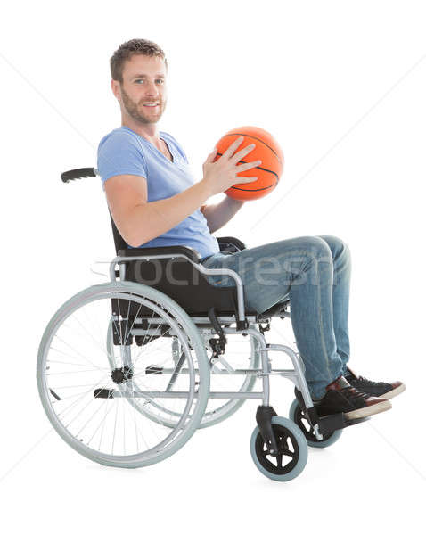 Disabled Player Holding Basketball On Wheelchair Stock photo © AndreyPopov