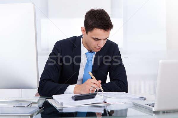 Businessman Computing Tax Stock photo © AndreyPopov