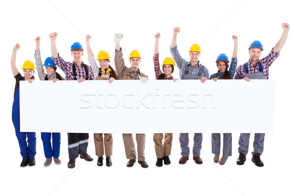 Group of workmen holding a blank white banner Stock photo © AndreyPopov