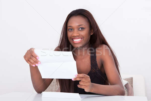 Woman Holding Document At Table Stock photo © AndreyPopov