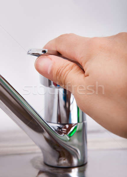 Hand Opening Chrome Water Tap  Stock photo © AndreyPopov