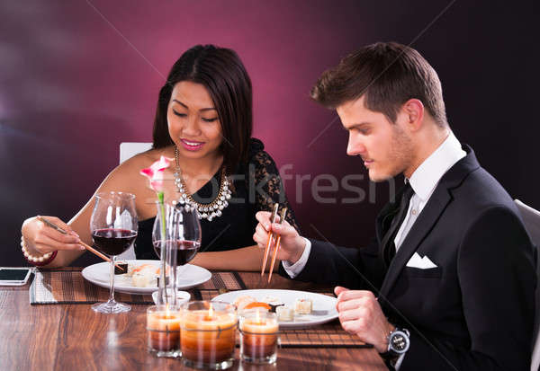Couple Having Meal At Restaurant Stock photo © AndreyPopov