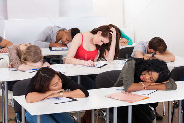Nudzić student snem biurko kobiet Zdjęcia stock © AndreyPopov