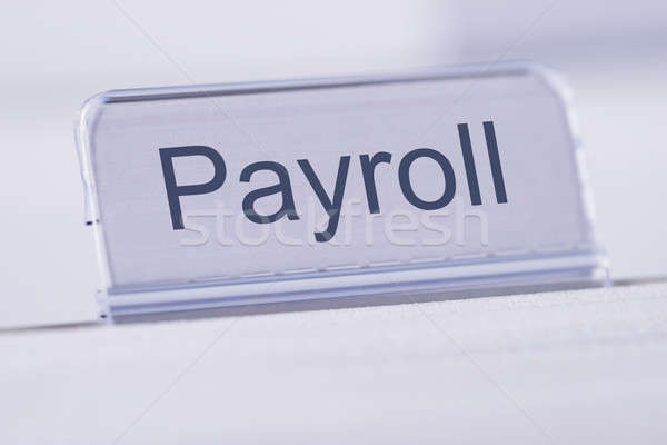 Payroll Tag On Table Stock photo © AndreyPopov