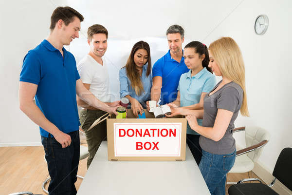People Putting Cans In Donation Box Stock photo © AndreyPopov
