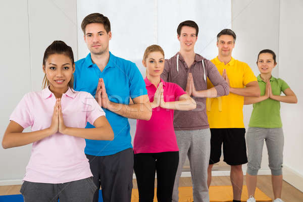 Multiethnic Group Of People Doing Yoga Stock photo © AndreyPopov