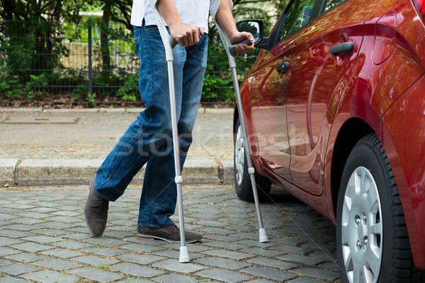 Discapacidad hombre muletas caminando atención primer plano Foto stock © AndreyPopov