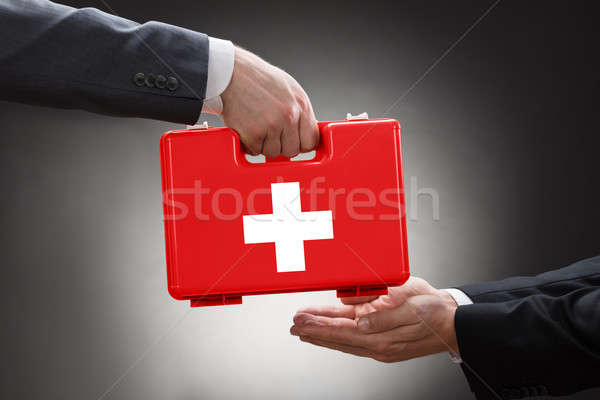Close-up Of A Person's Hand Giving First Aid Box Stock photo © AndreyPopov