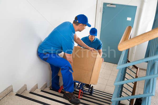 два окна лестница мужчины ходьбе дома Сток-фото © AndreyPopov