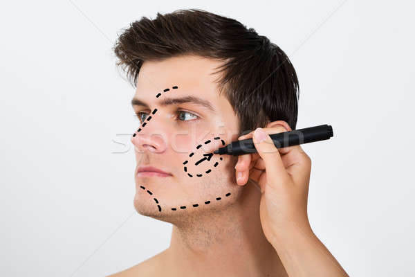 Person Hands Drawing Correction Lines On Male Face Stock photo © AndreyPopov