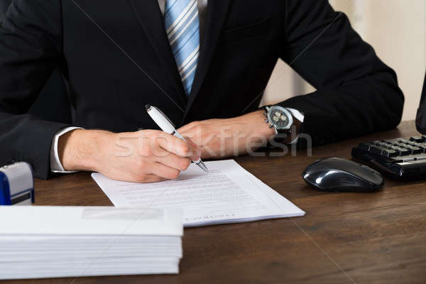 Businessman Signing Contract Paper Stock photo © AndreyPopov