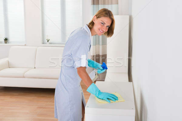 Female Janitor Cleaning Shelf Stock photo © AndreyPopov