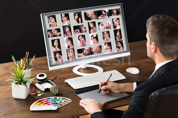 Photo Editor Using Graphic Tablet Stock photo © AndreyPopov