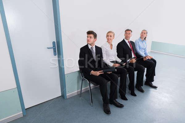 Posiedzenia krzesło biuro grupy wywiad kobiet Zdjęcia stock © AndreyPopov