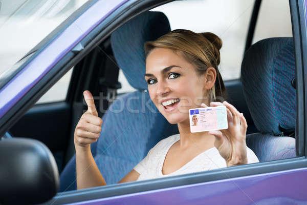 Kadın lisans oturma araba portre Stok fotoğraf © AndreyPopov