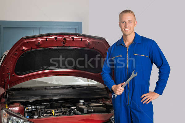 Smiling Mechanic Standing In Front Of Car Stock photo © AndreyPopov