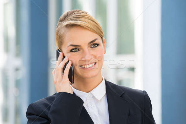 Businesswoman Using Cell Phone Outdoors Stock photo © AndreyPopov