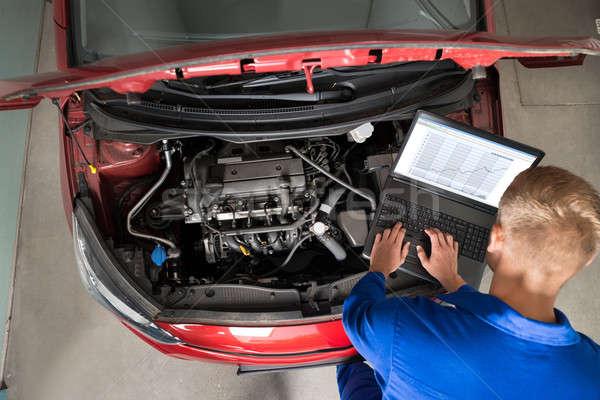 Mechanic Examining Car Engine With Help Of Laptop Stock photo © AndreyPopov