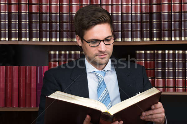 Stock photo: Advocate Reading Book At Courtroom