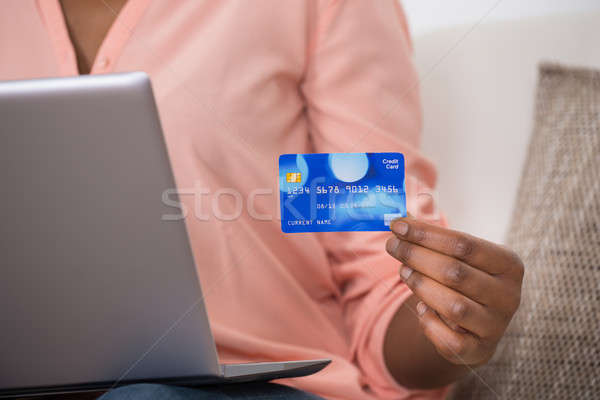 женщину дебетовая карточка ноутбука Сток-фото © AndreyPopov