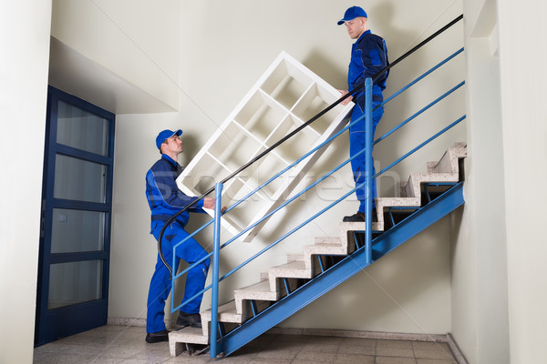 Movers Carrying Shelf While Climbing Steps Stock photo © AndreyPopov