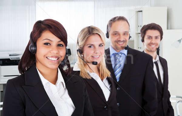 Call center sorridente escritório retrato negócio sorrir Foto stock © AndreyPopov