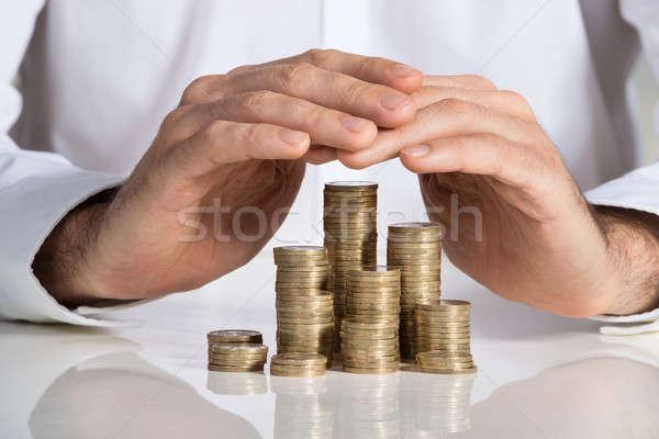 üzletember egymásra pakolva érmék asztal irodai asztal üzlet Stock fotó © AndreyPopov