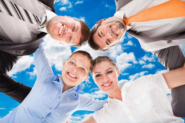 üzleti csapat égbolt közvetlenül alatt portré üzlet Stock fotó © AndreyPopov