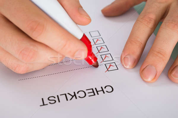 Person Hand Marking On Checklist Form Stock photo © AndreyPopov