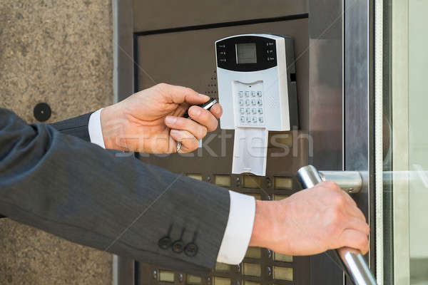 Businessperson Hand Operating Security System Stock photo © AndreyPopov
