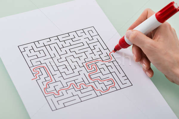 Woman Solving Maze Puzzle Stock photo © AndreyPopov