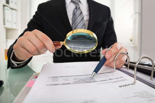Imprenditore foto lente di ingrandimento mutui documento Foto d'archivio © AndreyPopov