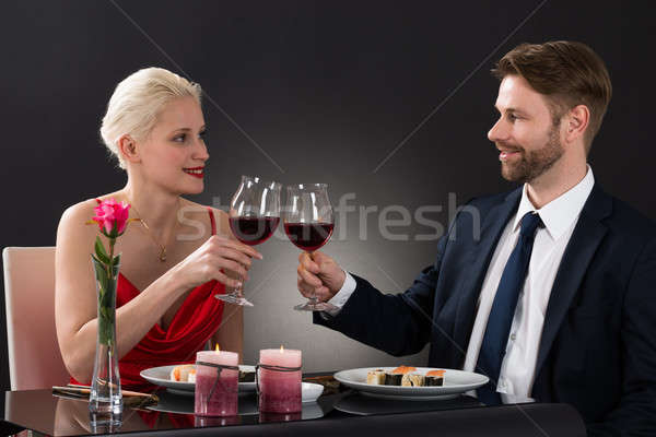 Young Couple Toasting Wine In A Restaurant Stock photo © AndreyPopov