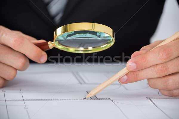 Architect Hand Using Magnifying Glass On Blueprint Stock photo © AndreyPopov