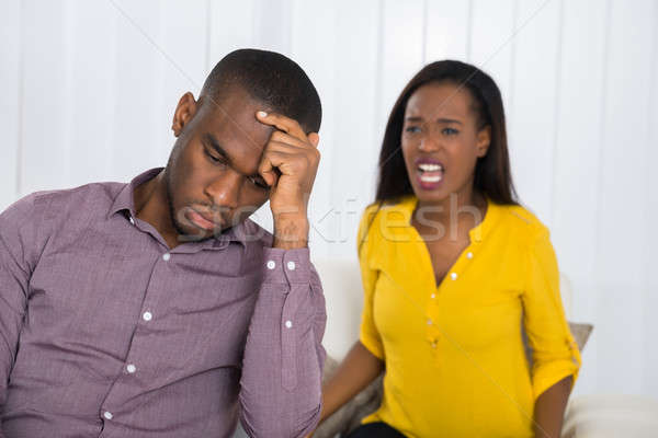 Kobieta argument człowiek nieszczęśliwy młoda kobieta domu Zdjęcia stock © AndreyPopov