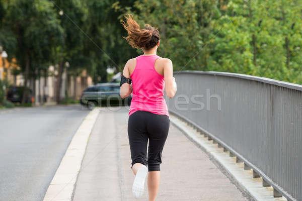 Fitness Woman Running On Sidewalk Stock photo © AndreyPopov