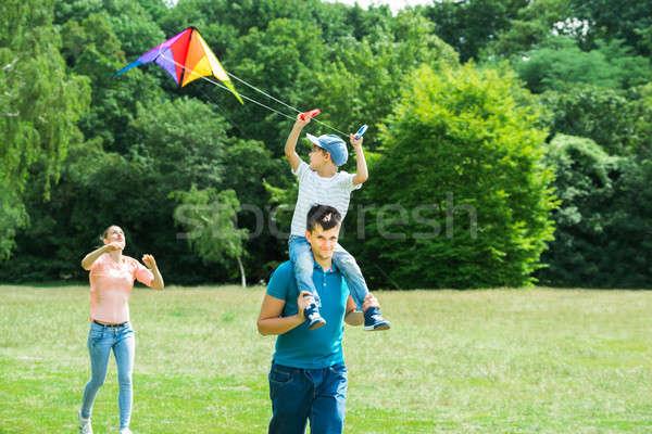 Family Flying Kite In The Park Stock photo © AndreyPopov