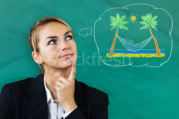 Thoughtful Woman Thinking Of Spending Vacation Stock photo © AndreyPopov