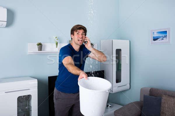 Man roepen loodgieter bezorgd lekkage water Stockfoto © AndreyPopov