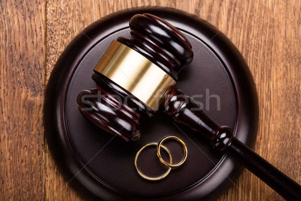Divorce Concept With Gavel And Wedding Rings Stock photo © AndreyPopov