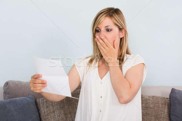 Sad Woman Reading Letter Stock photo © AndreyPopov