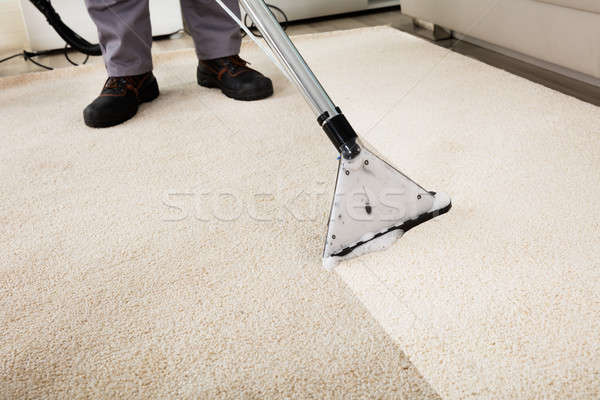 Person Cleaning Carpet With Vacuum Cleaner Stock photo © AndreyPopov
