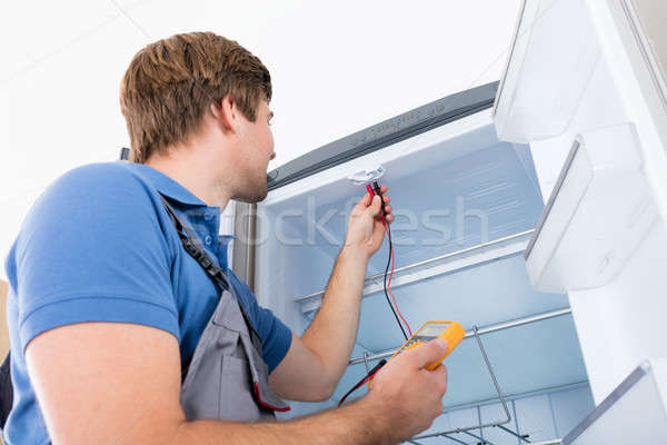 Male Technician Checking Refrigerator Stock photo © AndreyPopov