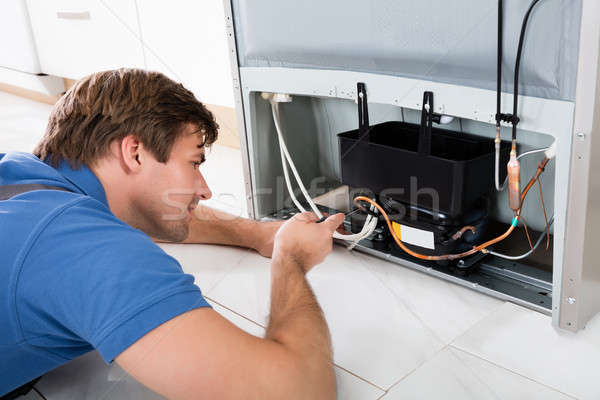 Technician Repairing Refrigerator Stock photo © AndreyPopov