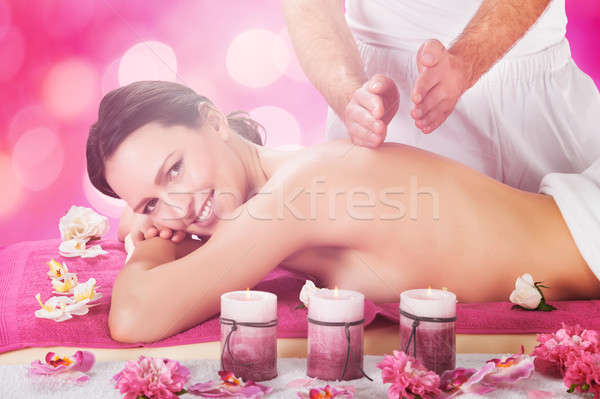 Woman Receiving Back Massage At Spa Stock photo © AndreyPopov
