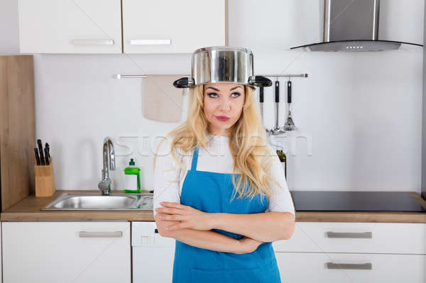 An Annoyed Woman With Cooking Pan On Head Stock photo © AndreyPopov